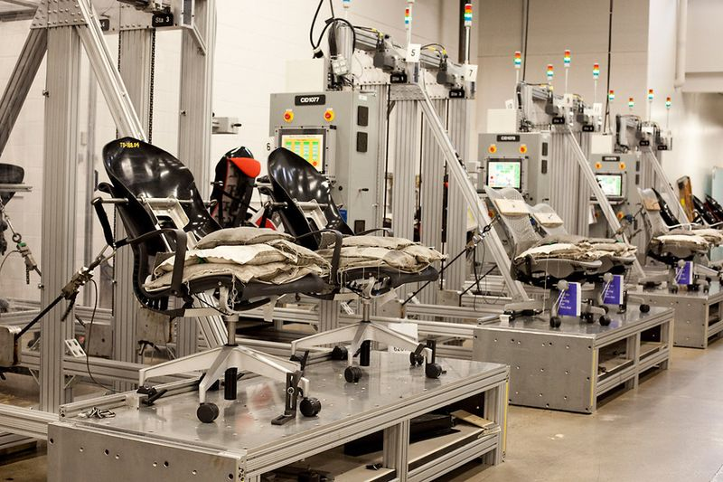 Herman Miller puts all Aeron chairs through stringent quality control tests. Here test chair backs are pulled by cables numerous times to insure quality and realiability