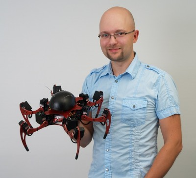 Kare Halversen aka Zenta is pictured here holding one of his other six-legged black widow spider robots