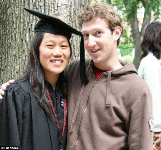 Mark Zuckerberg and Priscilla Chan pose together after her Harvard graduation ceremony