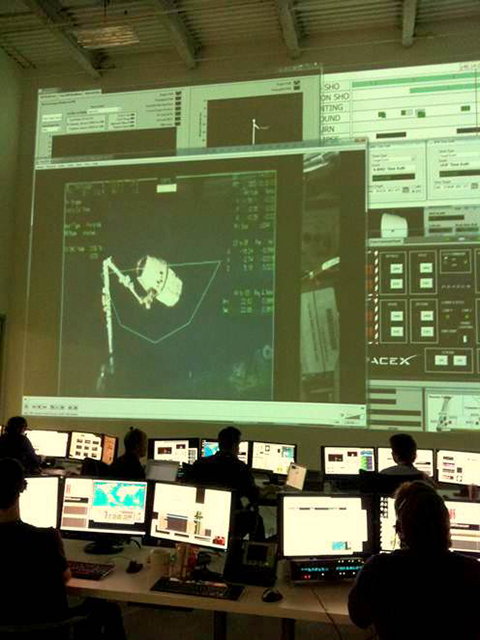 SpaceX Mission Control at the moment that the International Space Station's grapple arm connects with the Dragon spacecraft
