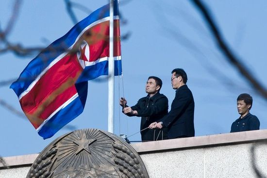 North Korean Embassy staff in Beijing lower their national flag on Monday to mourn Kim Jong Il's death.
