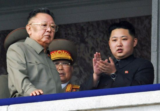 Kim Jong-il and his youngest son Kim Jong Un view a massive military parade