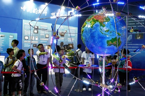 Visitors look at a model of the Beidou navigation system in Shanghai in May.