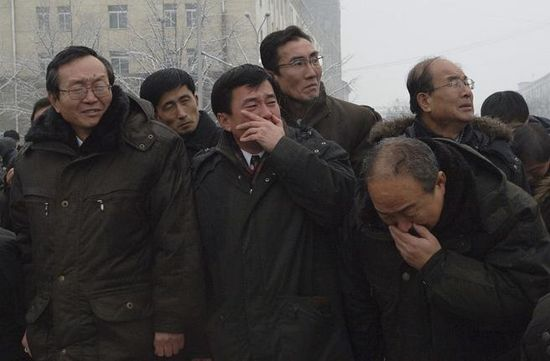 Mourners grieved during the funeral procession