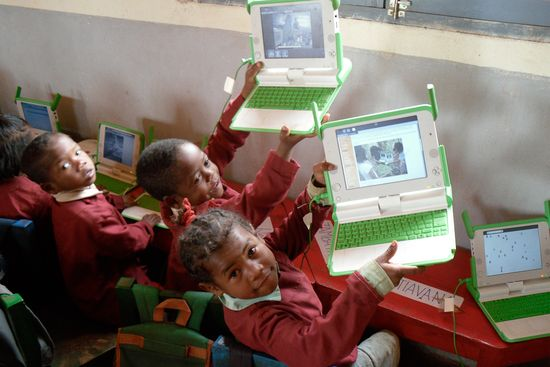 Children in Madagascar with their own OLPC OX-3 laptop