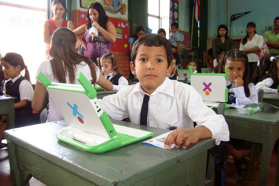 Children somewhere in Paraguay with their own OLPC XO-3 laptop