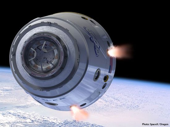 An artist's illustration of SpaceX's Dragon space capsule in Earth orbit