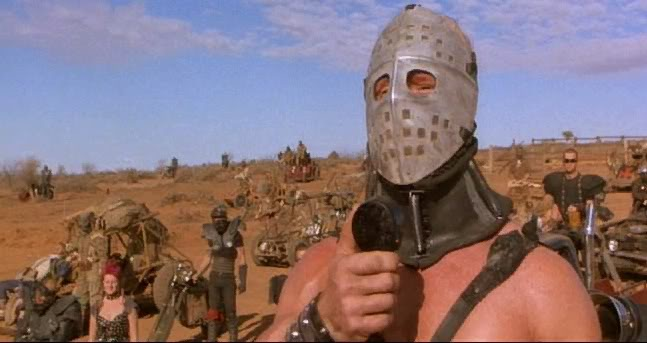 The notorious character 'Humongous' from the Road Warrior film.  Visions of the future economy.  All he wanted was some gas for his chopper, so he took matters into his own hands