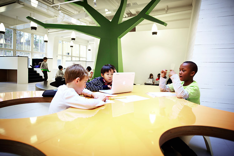 Vittra Telefonplan School has an organic table for working in smaller groups by Swedish design firm Rosan Bosch