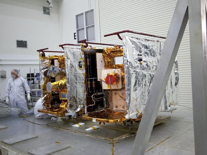 NASA's Gravity Recovery and Interior Laboratory, or GRAIL, twin spacecraft stand side by side as they are prepared for testing and processing
