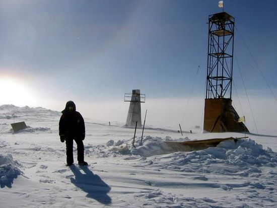 A man stands near drilling apparatus at the Vostok research camp in Antarctica