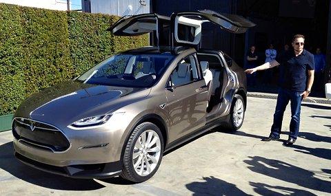 Elon Musk, chief executive of Tesla Motors, with the Model X prototype on Thursday, February 9, 2012