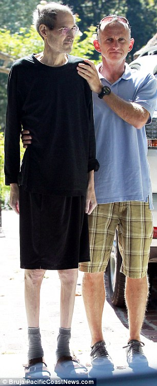 On August 21, 2011, Steve Jobs is helped into a car by a friend outside his home in California
