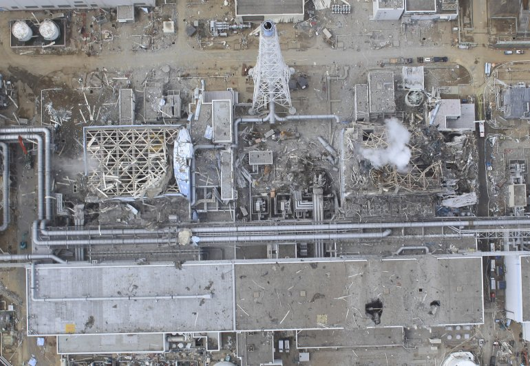 Aerial View of Fukushima Daichi Nuclear Power Plant. Note that the roofs two the reactors have been completely blown off
