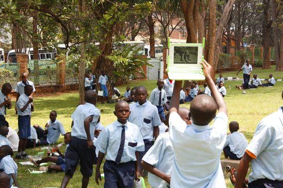 Children in Rwanda with their own OLPC XO-3 laptop