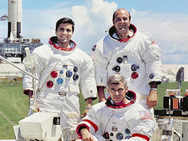Apollo 17 astronauts include Commander, Eugene A. Cernan (seated), Command Module pilot Ronald E. Evans (standing on right), and Lunar Module pilot, Harrison H. Schmitt
