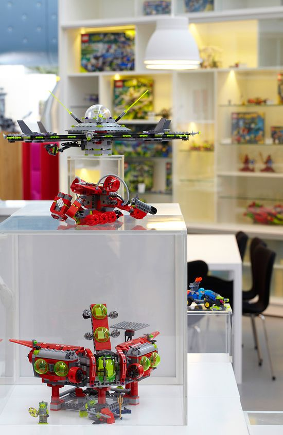 Lego PMD fantasy playroom office includes numerous pedestals and shelves displaying Lego toy models