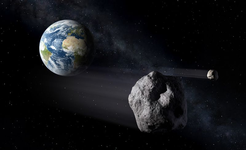 An artist's illustration of asteroids, or near-Earth objects, that highlight the need for a complete Space Situational Awareness system