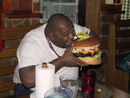 Fat-guy-eating-giant-hamburger