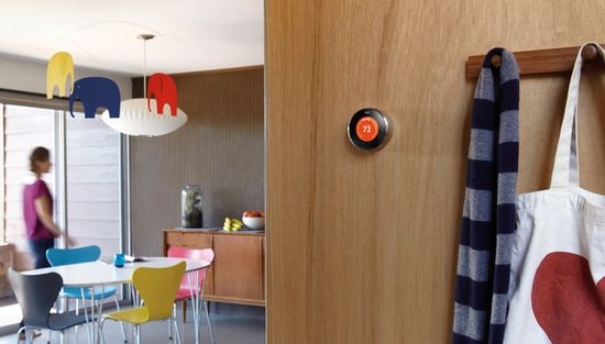 The Nest Thermostat prominently displayed on a wall in a modern day home