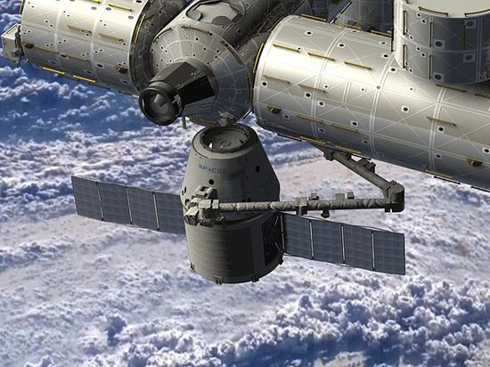 Artist illustration of SpaceX's Dragon spacecraft docking with the International Space Station