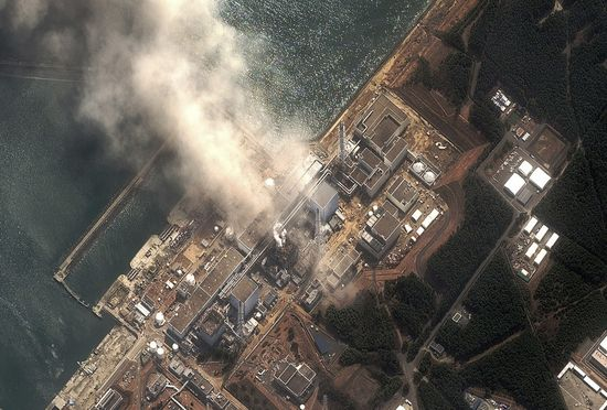 Satellite image of the Fukushima-Daiichi nuclear plant spews highly radioactive smoke from fires after the great earthquake and tidal wave that hit the plant