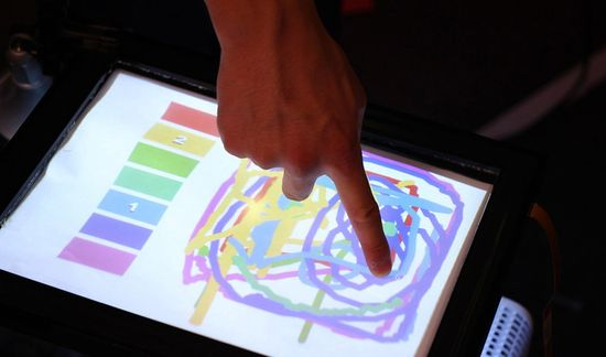 In this demo, users can each claim their own color. Then, whenever they touch the screen, they can paint in that color with no other prompts