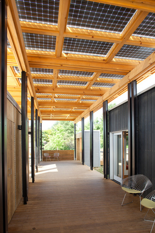 The Solar Homestead House's bifacial solar panels above the breezeway collect direct sunlight from above and reflected light from below