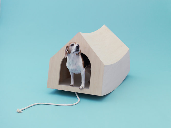 Muji's Architecture for Dogs include this MVRDV rocker dog house. The rocker bottom allows has less friction with the ground, so it can be dragged by the attached rope