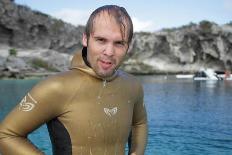 Alexey Molchanov poses after setting a new CWT freediving world record at Suunto Blue Dive 2012 at Dean's Blue Hole, Long Island Bahamas