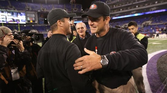 Head Coach Jim Harbaugh of the San Francisco 49ers embraces his brother Head Coach John Harbaugh of the Baltimore Ravens prior to the game at M&T Bank Stadium, Nov. 24, 2011, in Baltimore