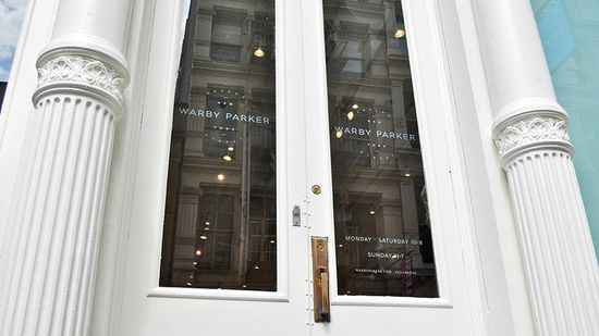 Front door entrance to the new Warby Parker store on Greene Street in the SOHO district of New York City