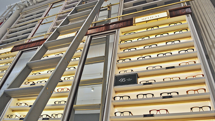 Sunglasses and optical glasses--men's and women's--are mixed throughout the display around the store