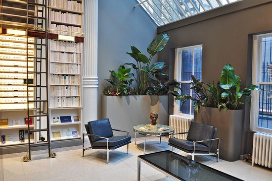 Books by 14 partner publishers in Warby Parker's lobby remind you just how bad you need to be at this place