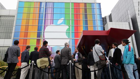 Journalists and attendees line up outside San Francisco's Yerba Buena Center for the Arts for the Apple iPhone 5 unveiling event on September 12, 2012