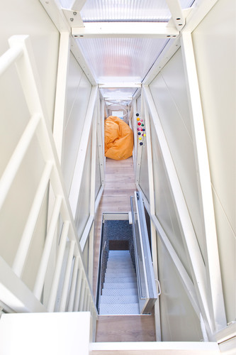 The entryway stairs actually fold up to become the first floor's floor!