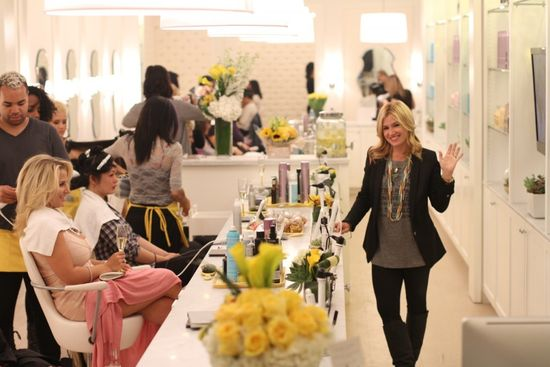 Drybar founder Allie Webb waves from the interior of her New York salon