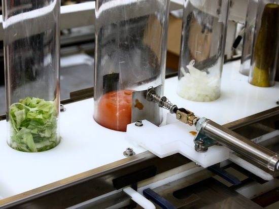 Momentum Machines robotic burger has feeding tubes that automatically add lettuce, tomatoes, onions and pickles to their hamburgers