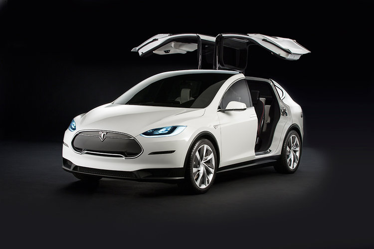 Tesla's Model X has 'falcon-wing' doors to squeeze up to five people in the back