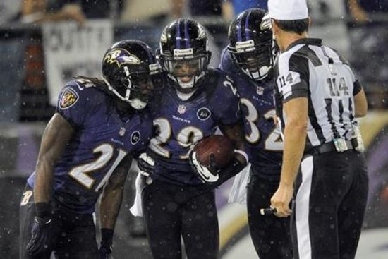 Ravens cornerback Cary Williams, center, celebrates his interception and touchdown with teammates cornerback Lardarius Webb, left, and defensive back James Ihedigbo during the second half against the Browns