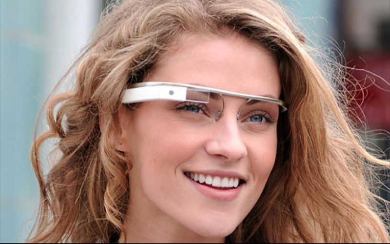 A beautiful young lady wears a prototype of Google's new augmented reality glasses