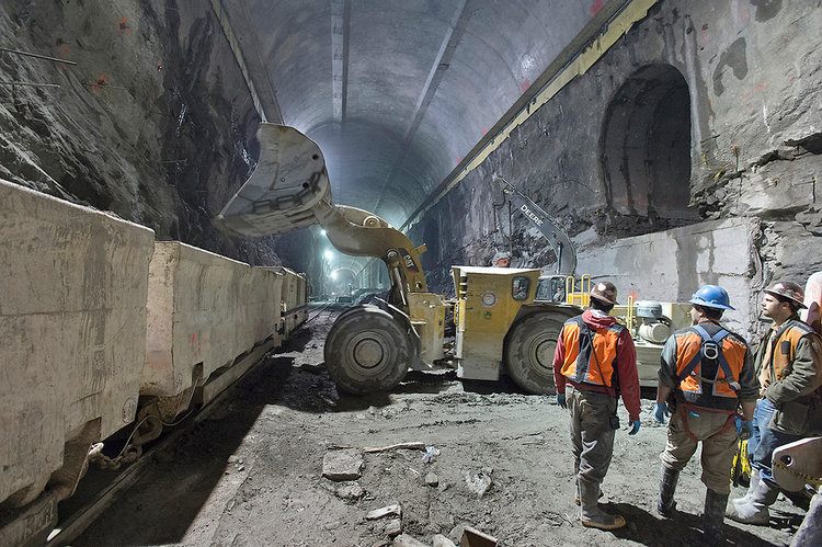 Underground tennel workers removing rock from new bored subway tunnels for the MTA Eastside Access Project running from Grand Central Station to Queens NY