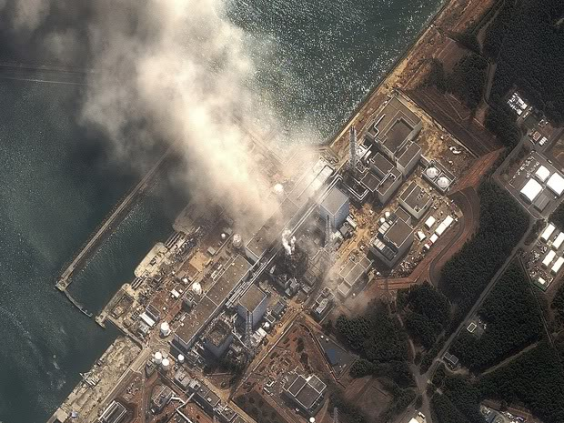 The No.3 nuclear reactor of the Fukushima Daiichi nuclear plant is seen burning after a blast following an earthquake and tsunami in this handout satellite image taken March 14, 2011