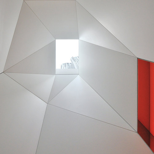 Aside from these whimsical touches, the space is a celebration of geometry. Here's the skylight in the foyer
