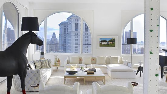 The ground floor houses the an expansive all-white living room with panoramic view of the New York City skyline