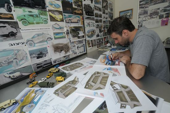 Plasan Chief Designer Nir Kahn works on sketches