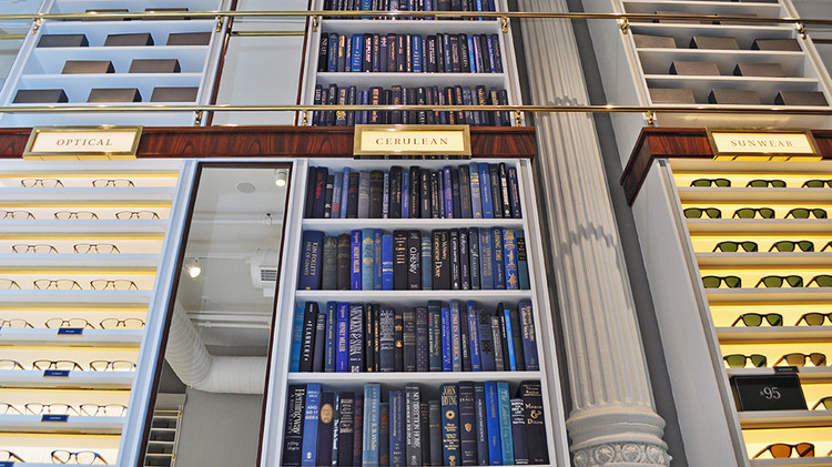 Literary themes abound -- The look of the store is inspired by a library. Books on Warby Parker's shelves are color-coded--eggshell, kelly, cerulean, crimson, and aubergine