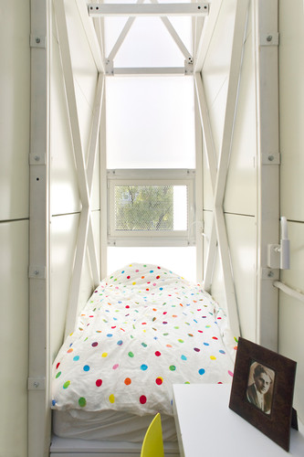 The sleeping quarters are on top, bathed in natural light from a translucent roof