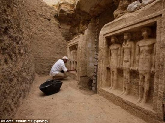 A researcher dusts off statues at the dig. The Czech mission is currently continuing investigation of the site and expect further surprising discoveries