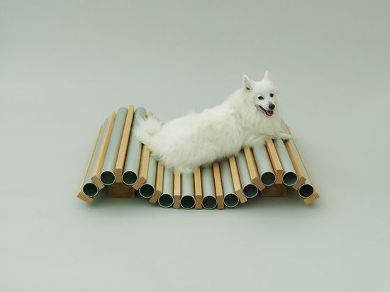 Muji's Archicture for Dogs includes Hiroshi Naito's piece for Spitz is a way to amplify the cold tile effect on a hot summer day. The aluminum tubes can be filled with ice to create a conductive, cooling sensation